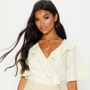 PrettyLittleThing Tops - Prettylittlething pale yellow frill wrap crop top2